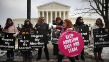 WASHINGTON, DC - JANUARY 18: Protesters on both sides of the abortion issue gather in front of the U.S. Supreme Court building during the Right To Life March, on January 18, 2019, in Washington, DC. (Photo by Mark Wilson/Getty Images)