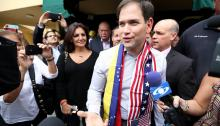 U.S. Senator Marco Rubio (R-FL) walks out of the El Arepazo 2 restaurant on February 28, 2014 in Doral, Florida. Rubio and Florida Governor Rick Scott held a meet and greet with the Venezuelan community to discuss the ongoing crisis in Venezuela. (Feb. 27, 2014 - Source: Joe Raedle/Getty Images North America)