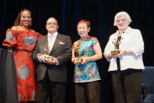 Chioma Ugochukwu, Provost of Cabrini University, presents Ray Yabor, Margaret Chin and Anne O' Sullivan with the 2019 Mother Cabrini Immigrant Heritage Award.  Photos: Peter Fitzpatrick/ALDIA News