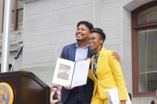 Amber Hikes is presented a state citation from Senator Malcolm Kenyatta for her service to the LGBTQ community on June 6, 2019. Photo: Emily Neil/AL DÍA News.