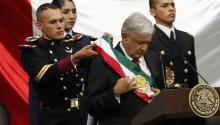 Leftist Andres Manuel Lopez Obrador (center) is adorned with the presidential sash after being sworn in as Mexico's new head of state at the headquarters of the Chamber of Deputies in Mexico City, Mexico. EFE/Jorge Núñez.