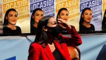 Ocasio-Cortez makes a stop in her campaign in Queens on Tuesday ( Reuters )