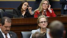 WASHINGTON, DC - OCTOBER 23: House Financial Services Committee member Rep. Alexandria Ocasio-Cortez (D-NY) questions Facebook co-founder and CEO Mark Zuckerberg with Rep. Jennifer Wexton (D-VA) during a hearing in the Rayburn House Office Building on Capitol Hill October 23, 2019, in Washington, DC. (Photo by Chip Somodevilla/Getty Images)