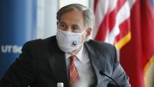 Texans are letting their governor know what they think of the mask mandate recall. But not everyone agrees. Photo: AP Images