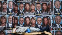 BUENOS AIRES, ARGENTINA - OCTOBER 28: A homeless sleeps next to posters advertising winning ticket of Frente de Todos represented by Alberto Fernandez and Cristina Fernandez on October 28, 2019, in Buenos Aires, Argentina. (Photo by Marcos Brindicci/Getty Images)