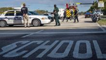 Several police officers guard Marjory Stoneman Douglas high school in the city of Parkland, Florida, USA, on February 15, 2018, where at least 17 people died in a new shooting, the eighteenth so far this year in educational centers of the country, in a massacre that is attributed to former student of Hispanic origin Nikolas Cruz. EFE / Cristobal Herrera