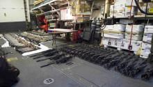 A cache of weapons is assembled on the deck of the USS Gravely.Humaniumcollects seized weapons to be recycled into different items. The Swedish group says it is currently negotiating with several global brands for the metal that comes from the recycled guns. It could be used for items ranging from jewelry to smartphone cases. Source: C. Dillon/U.S. Navy
