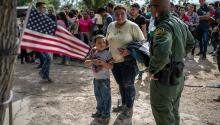 LOS EBANOS, TEXAS - JULY 02: A U.S. Border Patrol agent speaks to immigrants after taking them into custody on July 02, 2019 in Los Ebanos, Texas. (Photo by John Moore/Getty Images)