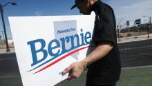 LAS VEGAS, NEVADA - FEBRUARY 18: A supporter of Democratic presidential candidate Sen. Bernie Sanders (I-VT) holds a 'Nevada For Bernie' sign on the final day of early voting for the upcoming Nevada Democratic presidential caucus on February 18, 2020 in Las Vegas, Nevada. (Photo by Mario Tama/Getty Images)
