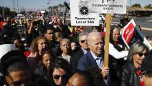 Democratic presidential candidate former Vice President Joe Biden walks on a picket line with members of the Culinary Workers Union Local 226 outside the Palms Casino in Las Vegas, on Feb. 19, 2020. (AP Photo/Patrick Semansky, File)