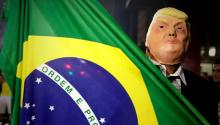 A sympathizer of Brazilian presidential candidate Jair Bolsonaro wears a mask of Donald Trump as he celebrates his victory on Sunday, October 28, 2018, on Avenida Paulista, in Sao Paulo (Brazil). The far right Jair Bolsonaro won the presidential elections in Brazil with 55.54% of the valid votes and will succeed the president Michel Temer on January 1, to govern the country until 2022. EFE/Fernando Bizerra