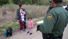 Border Patrol Agents take in to custody a 22-year-old women from El Salvador and her 5 and 3-year-old children after crossing the river from Mexico near Mission, Texas, on Tuesday, Feb. 26, 2019. Courtney Sacco/Caller-Times