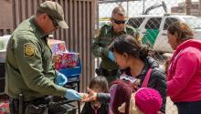 EL PASO, TX - MARCH 22: Image provided by the Office of Customs and Border Protection of Public Affairs of the United States, showing some immigrants after crossing the international border between the United States and Mexico, and surrendering to a border patrol agent. The migrants are taken to a processing center where they receive food and water, as well as medical attention if necessary, on March 22, 2019 in El Paso, Texas. (Photo by Mani Albrecht / Getty Images)