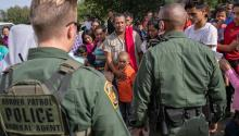 LOS EBANOS, TEXAS - JULY 02: U.S. Border Patrol agents watch over immigrants after taking them into custody on July 02, 2019 in Los Ebanos, Texas. (Photo by John Moore/Getty Images)