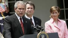 Then President George W. Bush speaks during the swearing-in ceremony of Brett Kavanaugh (C) to be a judge in 2006. Source: Getty.