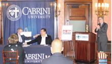 Cabrini University PresidentPh.D. Donald B. Taylor shakes hands with AL DIA CEO Hernán Guaracao.Photo: Oscar Lopez/AL DÍA News.