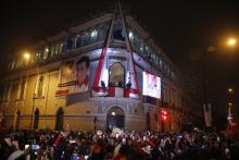 Pedro Castillo celebrates with Dina Boluarte from the balcony of his campaign headquarters in Lima, after being declared president of Peru by the electoral authorities. Monday, July 19, 2021. AP Photo by Guadalupe Prado.