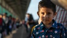 MATAMOROS, MEXICO - DECEMBER 09: Honduran asylum seeker, Christopher, 6, stands with his father on the international bridge from Mexico to the United States on December 09, 2019 in the border town of Matamoros, Mexico. (Photo by John Moore/Getty Images)