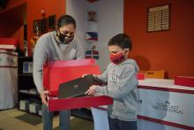 A student receives his laptop on Friday, Dec. 11. Photo: Telemundo 62