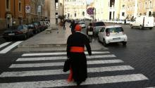 A cardinal walks through the the streets of the Vatican on his way to a meeting prior to the election of Pope Francis. March 5, 2013. Photo: © Alberto Vourvoulias