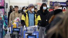 People wearing masks and gloves wait to checkout at Walmart on April 03, 2020, in Uniondale, New York. People wearing masks and gloves wait to checkout at Walmart on April 03, 2020, in Uniondale, New York. Al Bello/Getty Images