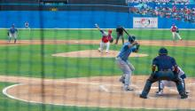 A pitcher from the Cuban National Baseball Team throws a pitch to a member of the Tampa Bay Rays as the two teams stage an exhibition game at the Estadio Latinoamericano in Havana, Cuba, on March 22, 2016, before an audience including U.S. President Barack Obama, Cuban President Raul Castro, and U.S. Secretary of State John Kerry. [State Department photo/ Public Domain]