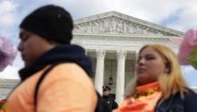WASHINGTON, DC - NOVEMBER 08: A police officer stands guard as student immigration activists participate in a rally defending Deferred Action for Childhood Arrivals (DACA) in front of the U.S. Supreme Court after they walked out from area high schools and universities November 8, 2019, in Washington, DC. (Photo by Alex Wong/Getty Images)
