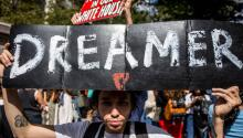 A young man marches for a definitive solution to undocumented immigrants arriving in the country as children. Source: http://fashthenation.com/