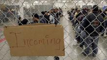 Undocumented immigrants wait in a detention center at the Border Patrol detention center in Nogales, Arizona (Reuters/Jeff Topping).