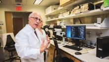 In his lab, Dr. Russo explains how fast cancer cells can develop, 2018. Photo: Sam Laub / AL DÍA News