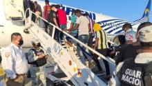 Haitian migrants return to their country on service flights. Photo: video capture