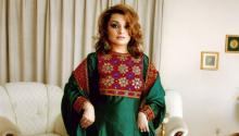 Dr. Bahar Jalali shows off her typical Afghan costume. Photo: Twitter @RoxanaBahar1
