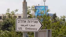 "A sign that reads ""Trump is a friend of Sion"", placed behind a sign indicates the direction to the US Embassy, on the occasion of its inauguration in Jerusalem, Israel, on Monday, May 14, 2018. EFE / Atef Safadi"