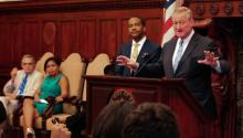 Mayor Jim Kenney addresses a crowd gathered at City Hall alongside City Solicitor Marcel Pratt in July. Greta Anderson / AL DÍA News