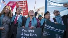 WASHINGTON, DC - MARCH 04: Rep. Debbie Mucarsel-Powell (D-FL), Rep. Jamie Raskin (D-MD), Rep. Sylvia Garcia (D-TX), Rep. Judy Chu (D-CA), Rep. Andy Levin (D-MI), and Rep. Lori Trahan (D-MA) participate in an abortion rights rally outside of the Supreme Court as the justices hear oral arguments in the June Medical Services v. Russo case on March 4, 2020 in Washington, DC. (Photo by Sarah Silbiger/Getty Images)