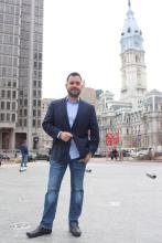 Fernando Treviño poses in front of Philadelphia's City Hall. Photo: Emily Neil/AL DÍA News.