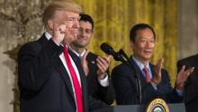US President Donald J. Trump (L) speaks about the opening of a Foxconn manufacturing plant in Wisconsin while Terry Gou (R), the founder and chairman of Foxconn, looks on in the East Room of the White House in Washington, DC, USA, 26 July 2017. EPA/JIM LO SCALZO
