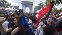 French supporters celebrate at the Arc de Triomphe after France won the 2018 World Cup during the 2018 FIFA final match between France and Croatia. EFE / EPA / IAN LANGSDON