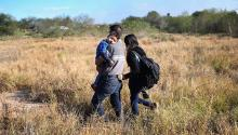 A father carries his sleeping son, 3, after their family illegally crossed the U.S.-Mexico border on December 7, 2015 near Rio Grande City, Texas. John Moore / Getty Images