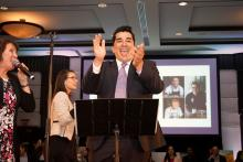 Chef Jose Garces pumps up the crowd during an auction at the Garces Foundation Benefit March 29 Photos: Peter Fitzpatrick/Al DIA News
