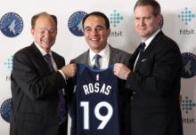 Minnesota Timberwolves President of Basketball Operations Gersson Rosas is introduced at a news conference with Timberwolves owner Glen Taylor (left) and team CEO Ethan Casson (right) in Minneapolis May 6, 2019. Photo: Dane Mizutani / Pioneer Press