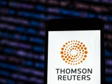 In this photo illustration, the Thomson Reuters Corporation Mass media company logo is seen displayed on a smartphone. Photo illustration: Igor Golovniov/SOPA Images/LightRocket via Getty Images.