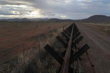 ANTELOPE WELLS, NEW MEXICO - JANUARY 30: A 'Normandy'-style border fence stretches along the U.S.-Mexico border on January 30, 2019 in Antelope Wells, New Mexico. Since October, dozens of large groups of 100 or more migrants have crossed the border into the remote 'Bootheel' region of southwest New Mexico to seek political asylum. Most of the new arrivals are Central American families and unaccompanied minors. (Photo by John Moore/Getty Images)