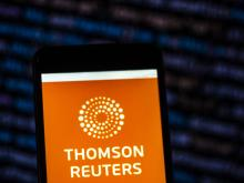 UKRAINE - 2018/11/22: In this photo illustration, the Thomson Reuters Corporation Mass media company logo seen displayed on a smartphone. (Photo Illustration by Igor Golovniov/SOPA Images/LightRocket via Getty Images)