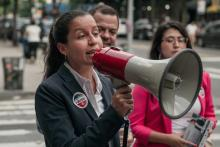 Public defender Tiffany Cabán, a candidate for Queens District Attorney, speaks with supporters in Jackson Heights, Queens hours before polls closed for the borough's Democratic primary election, June 25, 2019 in the Queens borough of New York City. Photo: Scott Heins/Getty Images.