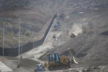Construction crews work on a border wall being put in place by We Build The Wall Inc. on June 01, 2019 in Sunland Park, New Mexico. Photo: Joe Raedle/Getty Images.