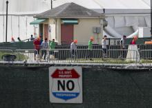 Young people walk the grounds of the Homestead Temporary Shelter for Unaccompanied Children as congress membersvisit the facility during an oversight tour on July 15, 2019 in Homestead, Florida. (Photo by Joe Raedle/Getty Images)