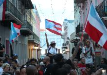 SAN JUAN, PUERTO RICO - JULY 16: Protesters demonstrate along a street leading to the Governors mansion as they call for Puerto Rican Governor Ricardo Rosselló to step down on July 16, 2019 in Old San Juan, Puerto Rico. The protesters are asking the governor to leave office after remarks that include derogatory terms against women and homophobic comments targeting singer Ricky Martin were leaked to the media from a private group chat. (Photo by Joe Raedle/Getty Images)