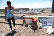 EL PASO, TEXAS - AUGUST 04: A woman walks away from a makeshift memorial outside Walmart, near the scene of a mass shooting which left at least 20 people dead, on August 4, 2019 in El Paso, Texas. Photo: Mario Tama/Getty Images