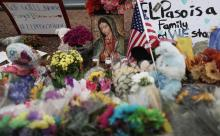 Flowers and mementos are seen at a makeshift memorial outside Walmart, near the scene of a mass shooting which left at least 20 people dead, on August 4, 2019 in El Paso, Texas. (Photo by Mario Tama/Getty Images)